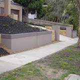 Water tank as a front fence and retaining wall.