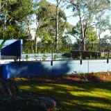 Pool water storing retaining wall